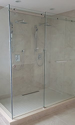 shower with glass walls and modern faucets