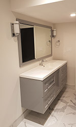 hanging vanity with mirror above it