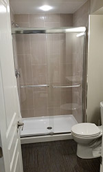 accessible shower with sliding glass doors