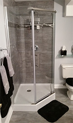 tiled shower with complimenting tile floor